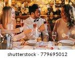 friends celebrating christmas... | Shutterstock . vector #779695012