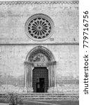 Small photo of Sulmona (L'Aquila, Abruzzi, Italy), facade of Santa Maria della Tomba church, in Plebiscito square. Black and white