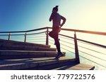 sporty female runner running... | Shutterstock . vector #779722576