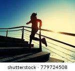 sporty fitness female runner... | Shutterstock . vector #779724508