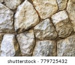 texture of the stone wall.... | Shutterstock . vector #779725432