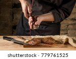 add pepper to beef steak with... | Shutterstock . vector #779761525
