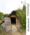 "Small photo of Myoban Onsen, Beppu, Japan - April 25 2017: View and details of a traditional straw-thatshed ""Yunohana"" hut, a folk culture asset to collect alum hot spring crystals"