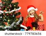Girl In Xmas Hat Plays With...