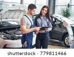 a man mechanic and woman... | Shutterstock . vector #779811466