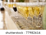 Rows Of Champagne Flutes On Bar ...