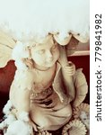 A Fairy Statue Underneath A...