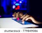 hands writing on touch screen... | Shutterstock . vector #779849086