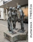 Small photo of Kristiansand, Norway - December 22, 2017: The statue called Paa Stripa, in Markensgate. Shopping street and pedestrian zone.