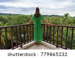 young woman in green dress is... | Shutterstock . vector #779865232
