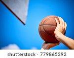 man holding a basketball | Shutterstock . vector #779865292