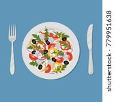 plate with salad on a blue... | Shutterstock .eps vector #779951638