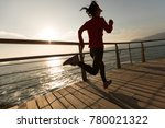 sporty fitness female runner... | Shutterstock . vector #780021322