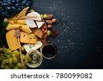 assortment of cheeses  a bottle ... | Shutterstock . vector #780099082
