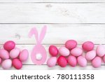 varicolored pink easter eggs... | Shutterstock . vector #780111358