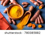 turmeric powder and fresh roots | Shutterstock . vector #780385882