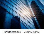 modern office building against... | Shutterstock . vector #780427342