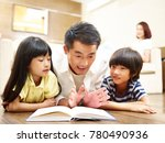 asian father and two children... | Shutterstock . vector #780490936