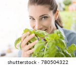 young smiling woman growing...   Shutterstock . vector #780504322
