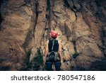 young climber getting ready | Shutterstock . vector #780547186
