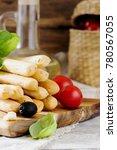 bread sticks with rosemary ...   Shutterstock . vector #780567055