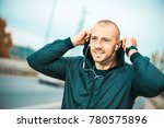 young man listening to music... | Shutterstock . vector #780575896