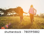 two sisters running on the lawn ... | Shutterstock . vector #780595882
