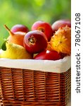Basket of tropical fruits. - stock photo