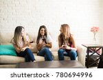 group of women relaxing at home ... | Shutterstock . vector #780694996