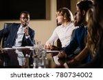 smiling black male boss talking ... | Shutterstock . vector #780734002