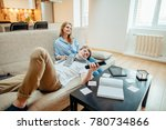 young couple watching movie on... | Shutterstock . vector #780734866