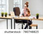 multitasking businesswoman... | Shutterstock . vector #780748825