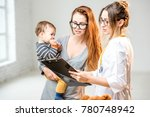 mother with her baby boy during ... | Shutterstock . vector #780748942