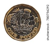 Small photo of 1 pound coin money (GBP), currency of United Kingdom isolated over white background