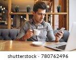 business man in a cafe talking...   Shutterstock . vector #780762496