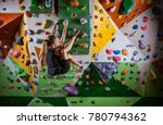 young woman bouldering on... | Shutterstock . vector #780794362