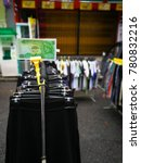 Small photo of Selangor, Malaysia - December 24, 2017: A stall is using photo of an actual money to replace the price tags at Car boot sale in Putra Mahkota.