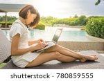 smart asian woman sitting... | Shutterstock . vector #780859555