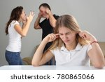 girl teenager closes ears in... | Shutterstock . vector #780865066