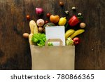 paper bag of different health... | Shutterstock . vector #780866365