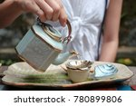 woman hand pouring hot tea from ...   Shutterstock . vector #780899806
