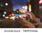 hand with a smart phone in a... | Shutterstock . vector #780954466