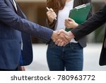Small photo of Close up touching and holding hands of men and women with secretary standing, clapping hands behind lawyer volunteering handshake with partner woman Confirmation will help in the fight against the law