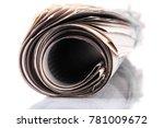 rolled newspaper on tablet | Shutterstock . vector #781009672