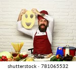 man with beard holds dough with ...   Shutterstock . vector #781065532