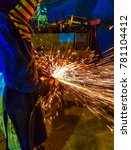 worker grinding metal in... | Shutterstock . vector #781104412