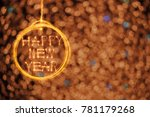 hang happy new year text in... | Shutterstock . vector #781179268
