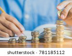 hand add coin to coin stack ... | Shutterstock . vector #781185112