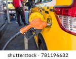 yellow car is fueled by an... | Shutterstock . vector #781196632