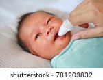 mother use finger to clean baby ...   Shutterstock . vector #781203832